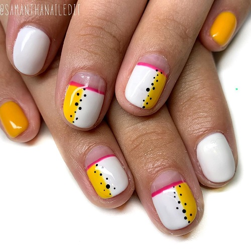 Cutest White and Yellow Nail Art with Black Dotted Design