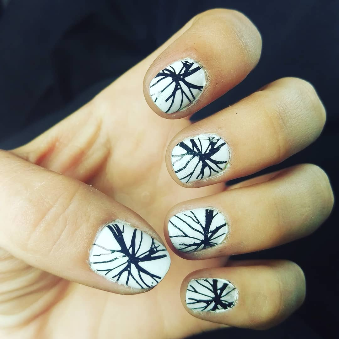 Pure White Nails with Black Spider Design Nail Art